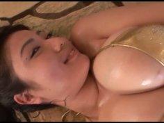 Comely brunette Asian babe Nonami Takizawa puts on shiny gold bikini