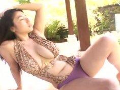 Gorgeous brunette Nonami Takizawa has big tits under her leopard print lingerie